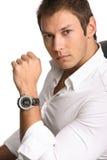 Hombre de negocios con el reloj foto de archivo libre de regalías