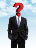 Hombre de negocios con el signo de interrogación en vez de la cabeza Foto de archivo