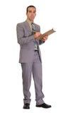 Hombre de negocios con el sujetapapeles Imagenes de archivo