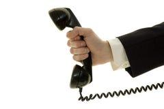 Hombre de negocios con el teléfono Foto de archivo libre de regalías