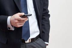 Hombre de negocios con el teléfono elegante Fotografía de archivo