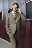 Hombre de negocios con el teléfono móvil j Imágenes de archivo libres de regalías