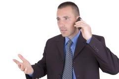 Hombre de negocios con el teléfono celular Fotografía de archivo libre de regalías