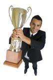 Hombre de negocios con el trofeo Imágenes de archivo libres de regalías