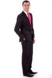 Hombre de negocios con estilo que presenta a la cámara Fotografía de archivo libre de regalías