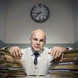 Hombre de negocios con exceso de trabajo Fotografía de archivo