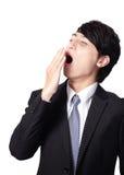 Hombre de negocios con exceso de trabajo que bosteza Imagenes de archivo