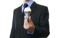 Hombre de negocios con la bombilla del LED Fotos de archivo libres de regalías