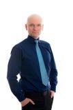 Hombre de negocios con la cabeza calva delante del fondo blanco Fotografía de archivo libre de regalías