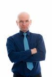Hombre de negocios con la cabeza calva delante del fondo blanco Foto de archivo libre de regalías