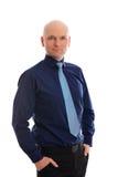 Hombre de negocios con la cabeza calva delante del fondo blanco Fotografía de archivo