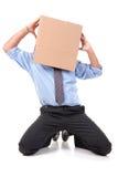 Hombre de negocios con la cabeza de la caja Imagenes de archivo