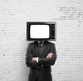 Hombre con la cabeza de la TV Foto de archivo libre de regalías
