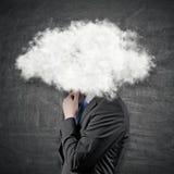 Hombre de negocios con la cabeza en nubes Imágenes de archivo libres de regalías