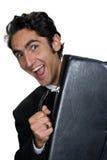 Hombre de negocios con la caja de cuero negra. Imagen de archivo libre de regalías