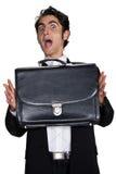 Hombre de negocios con la caja de cuero negra. Fotos de archivo
