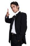 Hombre de negocios con la caja de cuero negra. Fotos de archivo libres de regalías