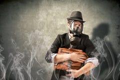 Hombre de negocios con la careta antigás Imagen de archivo libre de regalías