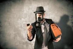 Hombre de negocios con la careta antigás Foto de archivo