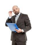 Hombre de negocios con la carpeta azul Imágenes de archivo libres de regalías