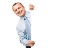 Hombre de negocios con la cartelera en blanco Foto de archivo