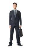 Hombre de negocios con la cartera Imagen de archivo libre de regalías