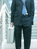Hombre de negocios con la cartera Imágenes de archivo libres de regalías