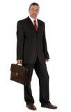 Hombre de negocios con la cartera aislada en el fondo blanco fotografía de archivo