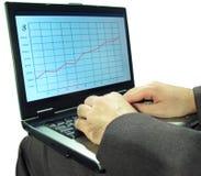 Hombre de negocios con la computadora portátil Imagen de archivo libre de regalías