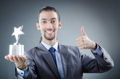 Hombre de negocios con la concesión de la estrella Imagenes de archivo
