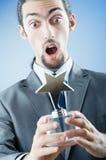 Hombre de negocios con la concesión de la estrella Foto de archivo libre de regalías
