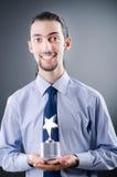 Hombre de negocios con la concesión de la estrella Fotografía de archivo libre de regalías