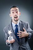Hombre de negocios con la concesión de la estrella Fotografía de archivo