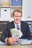Hombre de negocios con la fan euro del dinero Imagenes de archivo