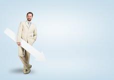 Hombre de negocios con la flecha Imagen de archivo