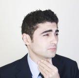 Hombre de negocios con la garganta dolorida imagen de archivo libre de regalías