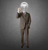 Hombre de negocios con la lámpara-pista y la etiqueta de plástico foto de archivo libre de regalías