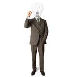 Hombre de negocios con la lámpara-pista y la etiqueta de plástico foto de archivo