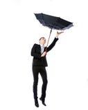 Hombre de negocios con la lucha del paraguas Imagen de archivo libre de regalías