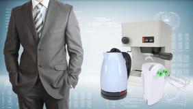Hombre de negocios con la máquina del café, caldera y Foto de archivo libre de regalías