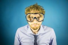 Hombre de negocios con la máscara del salto Imagenes de archivo