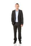Hombre de negocios con la mano en bolsillo Fotos de archivo