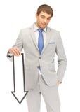 Hombre de negocios con la muestra de la flecha de la dirección Fotos de archivo libres de regalías