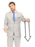 Hombre de negocios con la muestra de la flecha de la dirección Fotos de archivo