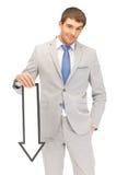 Hombre de negocios con la muestra de la flecha de la dirección Imágenes de archivo libres de regalías
