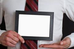 Hombre de negocios con la muestra en blanco Fotografía de archivo