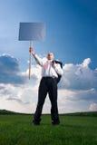 Hombre de negocios con la muestra en blanco Fotos de archivo libres de regalías