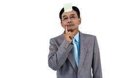 Hombre de negocios con la nota en blanco sobre la frente Foto de archivo libre de regalías
