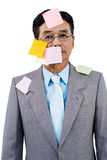 Hombre de negocios con la nota en blanco sobre su cara Imagenes de archivo