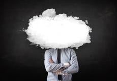 Hombre de negocios con la nube blanca en su concepto principal imagen de archivo